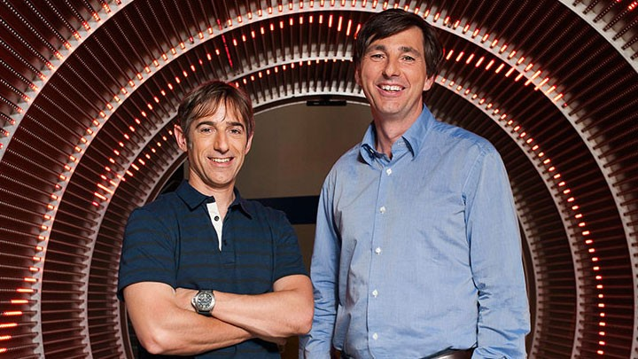 New/Old Zynga CEO Mark Pincus and former CEO Don Mattrick, standing in what appears to be the barrel of a giant rifle.